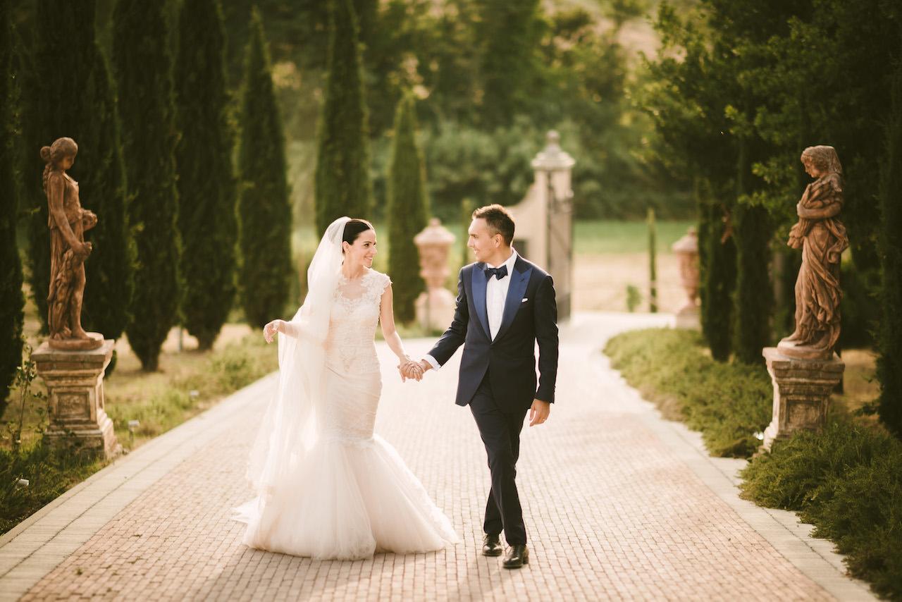 Bride and groom portrait while walking at Tenuta Corbinaia in Tuscany countryside