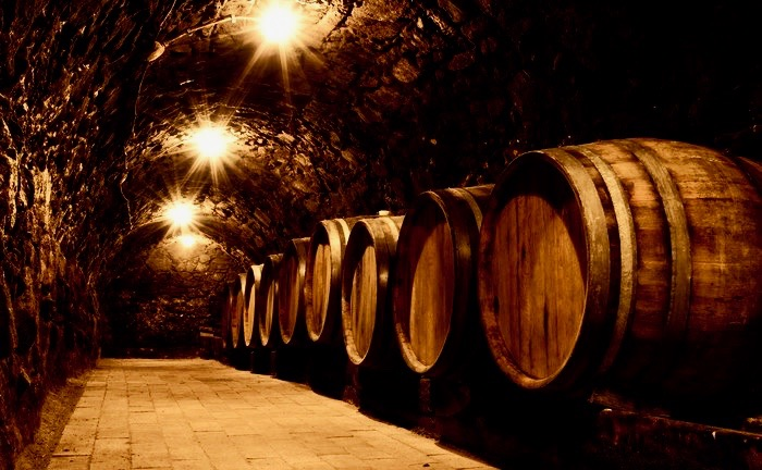 Oak barrels in the tunnel of Tokaj winery cellar, Hungary